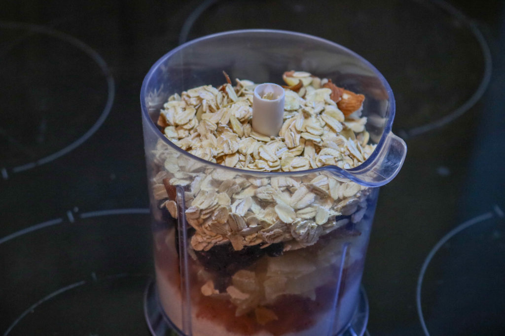 Add almonds and oats to Food Processor