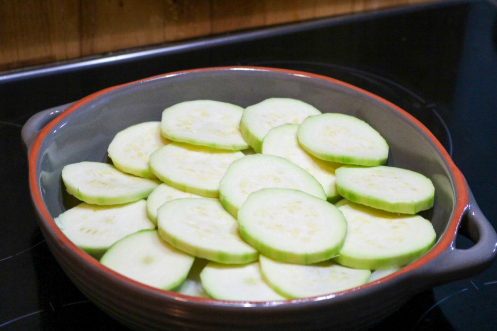 Layer zucchini on onions