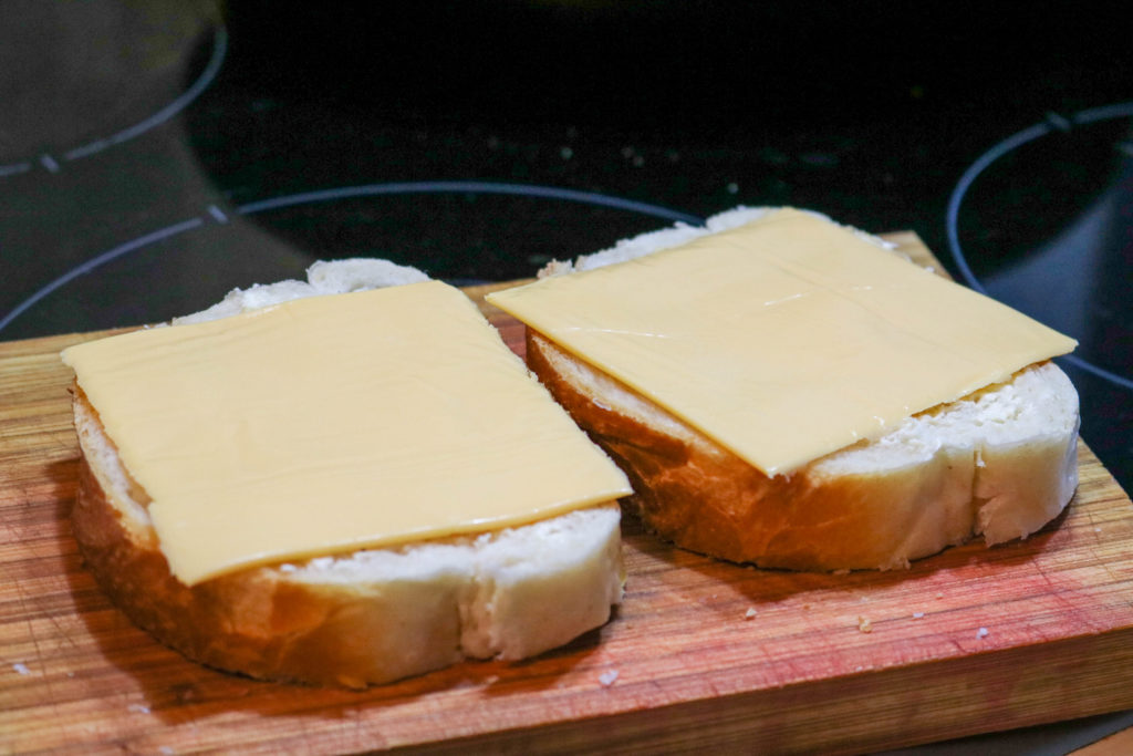 Place Cheddar Cheese on Bread