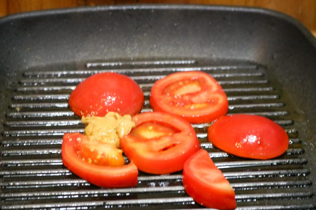 Add Tomato and Salt to Skillet