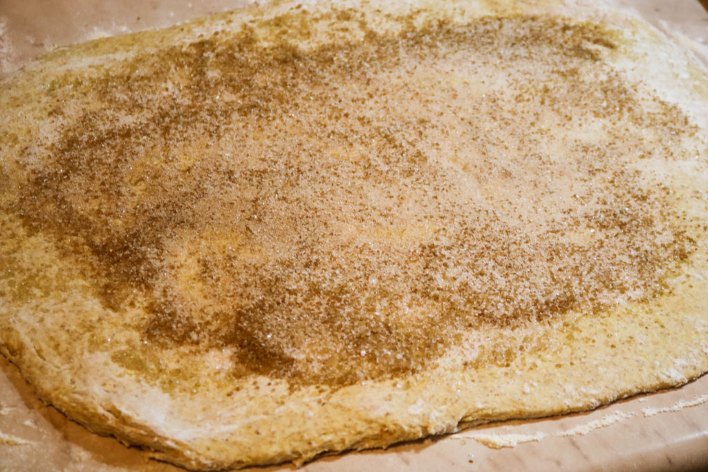 Sprinkle cinnamon sugar over the dough