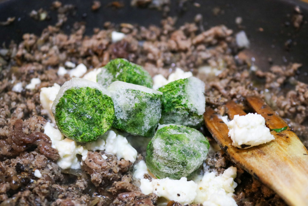 Stir spinach and feta into the beef mixture