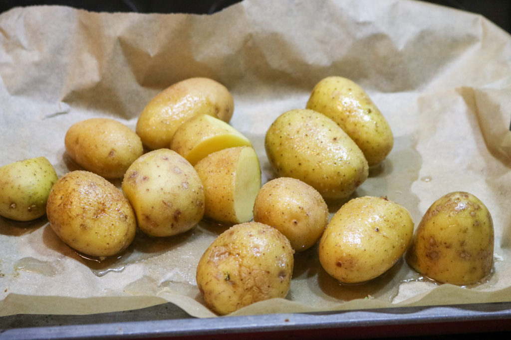 Place potatoes in the baking pan