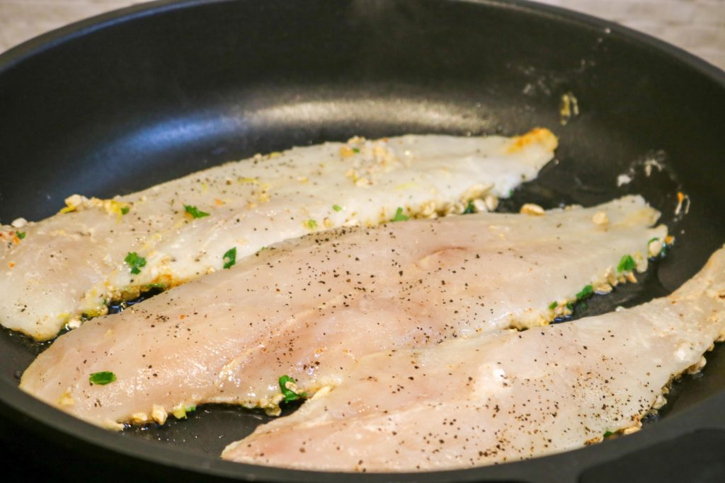 Place fish into the pan