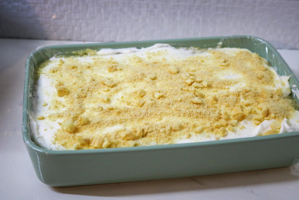 Sprinkle crushed lady fingers over the banana pudding