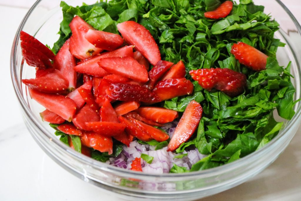 toss together spinach, strawberries and onion.