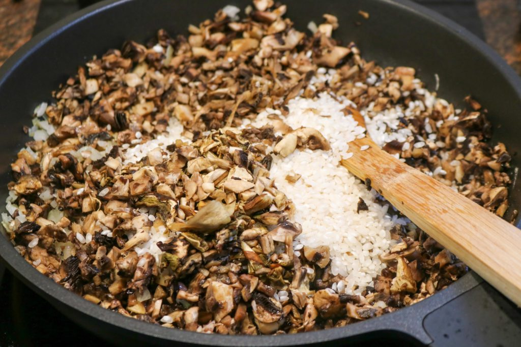 Stir in rice and cook for about 3 minutes until slightly toasted