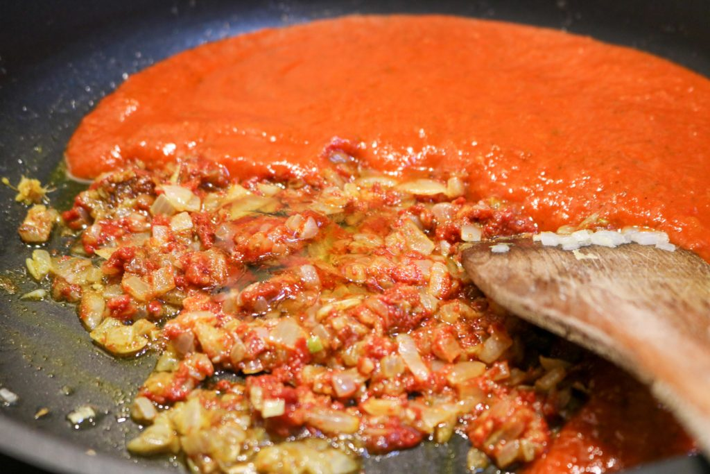 Add tomato puree and honey, and bring to a simmer