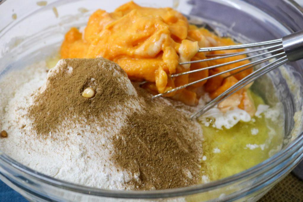 add a third of the flour mixture, then half the pumpkin mixture