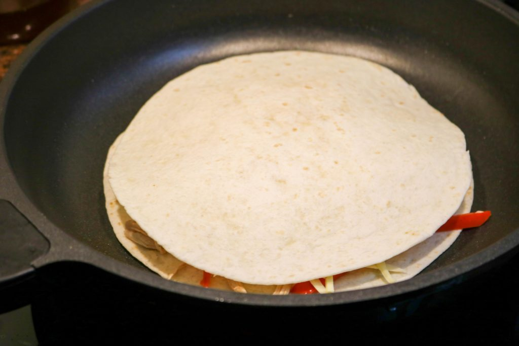 Cook tortillas one at a time for 3 to 5 minutes per side